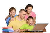 Happy family on the computer. — Stock Photo