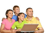 Family at the computer — Stock Photo