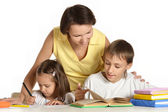 Mother helping her kids — Stock Photo