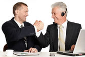 Old and young businessmen — Stock Photo