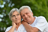 Beauteous aged couple in the park — Stock Photo