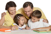 Mother and father helping their kids — Stock Photo