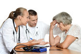 Old woman and doctors — Stock Photo
