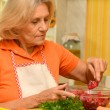 Cute elderly woman preparing — Stock Photo