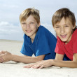 Children lie on the sand — Stock Photo #30432159