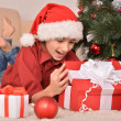 Portrait of a happy kid with gift — Stock Photo