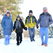 Family in winter park — Stock Photo #30432275