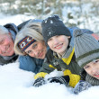 Familyin winter park — Stock Photo #30432333
