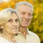 Portrait of mature couple in park — Stock Photo #30432341