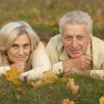 Elderly couple outdoors — Stock Photo #30432359