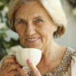 Mature woman with tea cup — Stock Photo #30432427