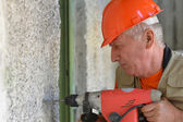 Man does the construction work with the punch — Stock Photo