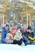 Familyin winter park — Stock Photo