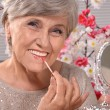 Portrait of a happy aged woman in studio — Stock Photo #30478901