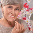 Stock Photo: Portrait of happy aged womin studio