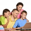 Kids doing homework with parents — Stock Photo