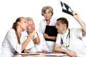 Doctors sitting at table — Stock Photo