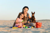 Happy family on a beach — Stock Photo