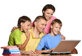 Kids doing homework with parents — Stock Photo