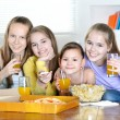 Cheerful girls watching TV — Stock Photo