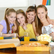 Four cheerful girls relaxing — Stock Photo #30735309