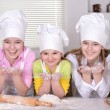 Young girls cook — Stock Photo