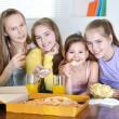 Cheerful girls watching TV — Stock Photo