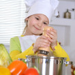 Girl  cooking soup — Stock Photo