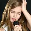 Cute  girl singing — Stock Photo