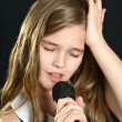 Cute girl singing — Stock Photo #30736481