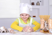 Lovely girl in a hat chef — Stock Photo