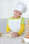 Girl knead the dough — Stock Photo