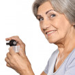 Senior woman taking medicine — Stock Photo