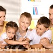 Stock Photo: Family playing lotto