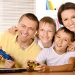 Family playing video games — Stock Photo #30859941