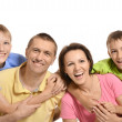 Cheerful family of four — Stock Photo #30859993