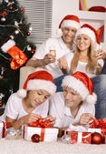 Family celebrating New Year — Stock Photo
