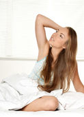 Young girl in bed — Stock Photo