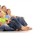 Family sitting on the floor — Stock Photo #30860059