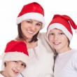 Stock Photo: Mom with kids in santa hats