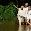 Stock Photo: Glorious family went to river