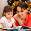 Lovely mother decided to read to her children  — Stock Photo