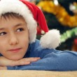 Boy in santa hat lying — Stock Photo