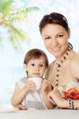 Charming woman with daughter at the resort — Stock Photo