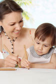 Beauteous woman with daughter at the resort — Stock Photo