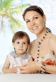 Nice woman with daughter at the resort — Stock Photo