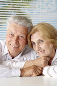 Charming old people at the resort — Stock Photo