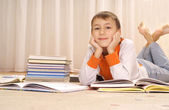 Nice boy does homework — Stock Photo