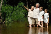 Glorious family went to the river — Stock Photo