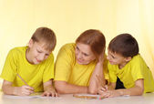 Adorable people in yellow t-shirts — Stock Photo